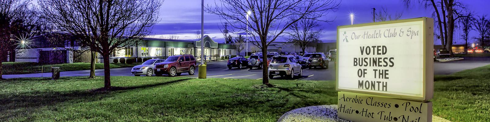 Our Health Club & Spa exterior night scene